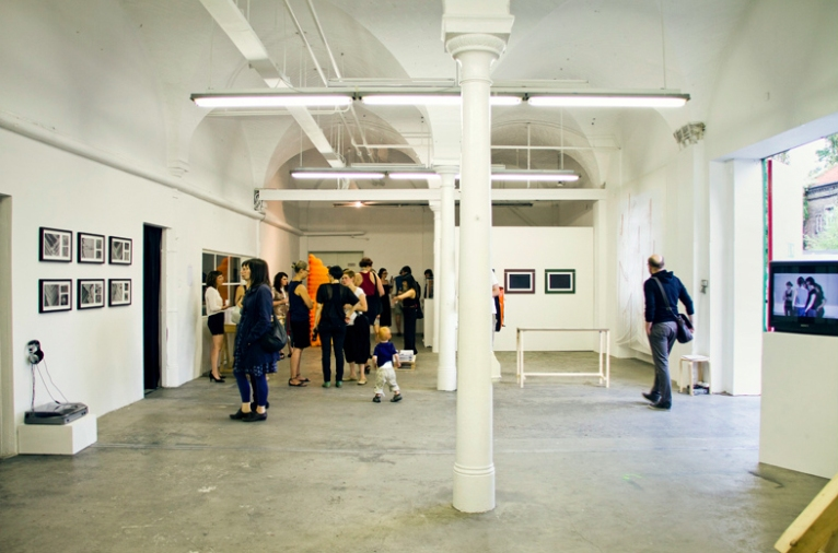 Installation view at the opening looking towards south gallery